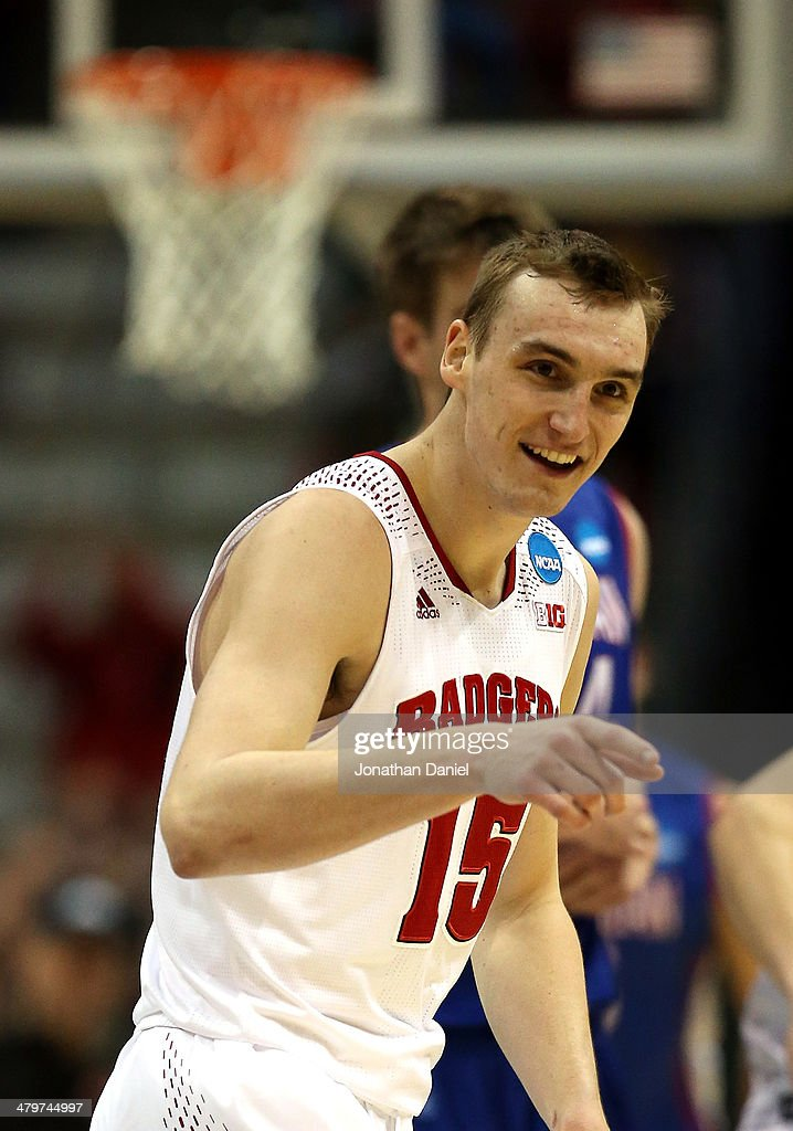 <a gi-track='captionPersonalityLinkClicked' href=/galleries/search?phrase=Sam+Dekker&family=editorial&specificpeople=7887140 ng-click='$event.stopPropagation()'>Sam Dekker</a> #15 of the Wisconsin Badgers reacts after scoring during the second round game of the NCAA Basketball Tournament against the American University Eagles at BMO Harris Bradley Center on March 20, 2014 in Milwaukee, Wisconsin.