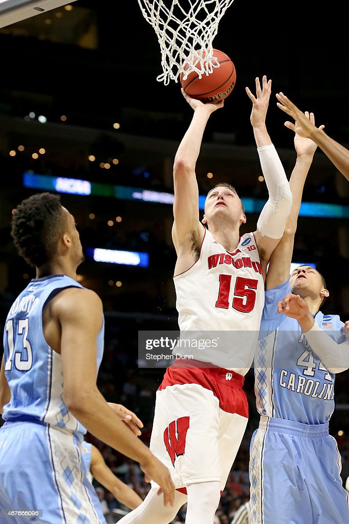 Sam Dekker of the Wisconsin Badgers shoots in front of Justin Jackson of the North Carolina Tar Heels in the first half during the West Regional...