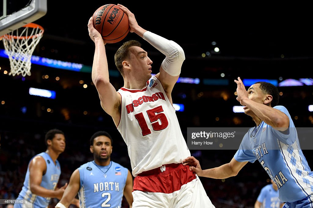 Sam Dekker of the Wisconsin Badgers with the ball against Marcus Paige of the North Carolina Tar Heels in the second half during the West Regional...