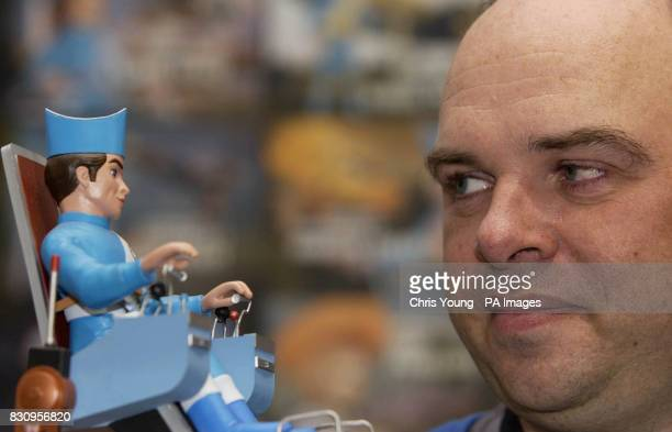 Sam Denham the coeditor of 'Thunderbirds the Classic Comic Strips' looks at a model of the character Scott Tracey at the Animation Art Gallery in...