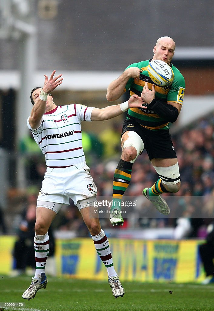 Sam Dickinson of Northampton takes a high ball ahead of Fergus Mulchrone of London Irish during the Aviva Premiership match between Northampton Saints and London Irish at Franklins Gardens on February 13, 2016 in Northampton, England.
