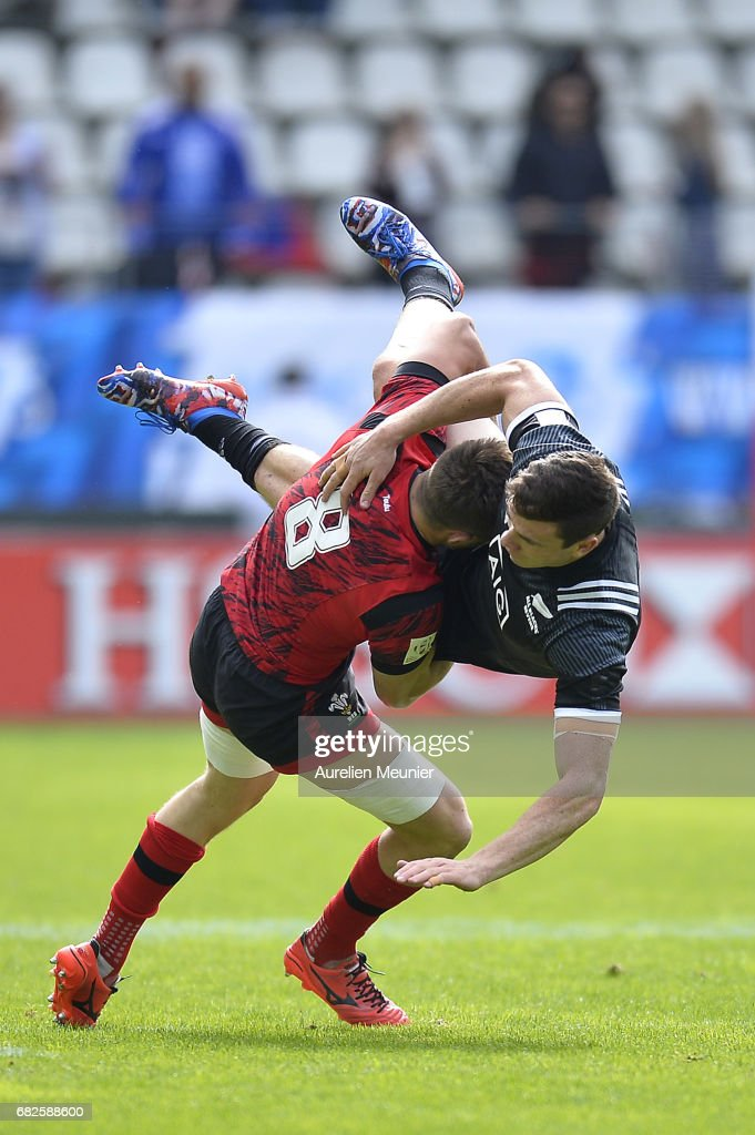 Sam Dickson of New Zealand is tackled by Lloyd Evans of Wales during the HSBC rugby sevens match between New Zealand and Wales on May 13, 2017 in Paris, France.