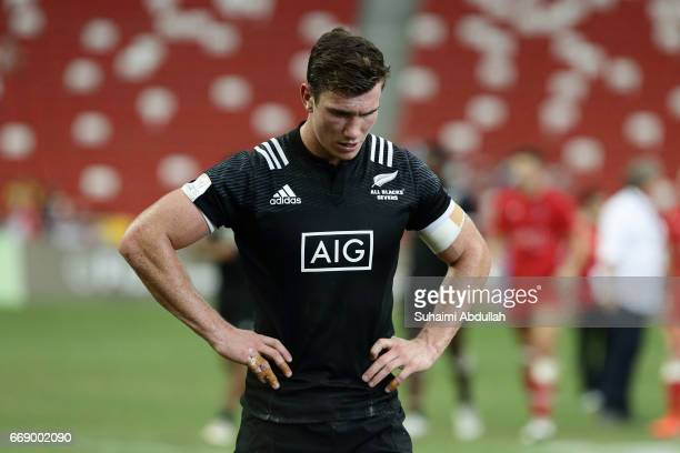 Sam Dickson of New Zealand reacts after losing to Canada Canada during the Cup Quarter Finals 2017 Singapore Sevens at National Stadium on April 16...