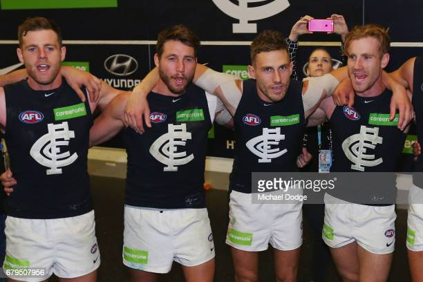 Sam Docherty Dale Thomas Billy Smedts and Nick Graham of the Blues sing the club song after winning during the round seven AFL match between the...