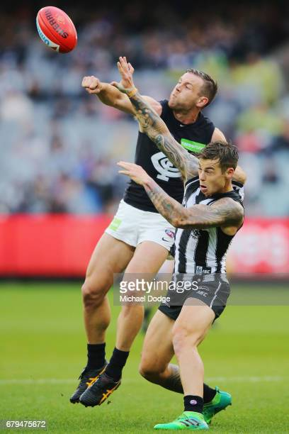 Sam Docherty of the Blues and Jamie Elliott of the Magpies compete for the ball during the round seven AFL match between the Collingwood Magpies and...