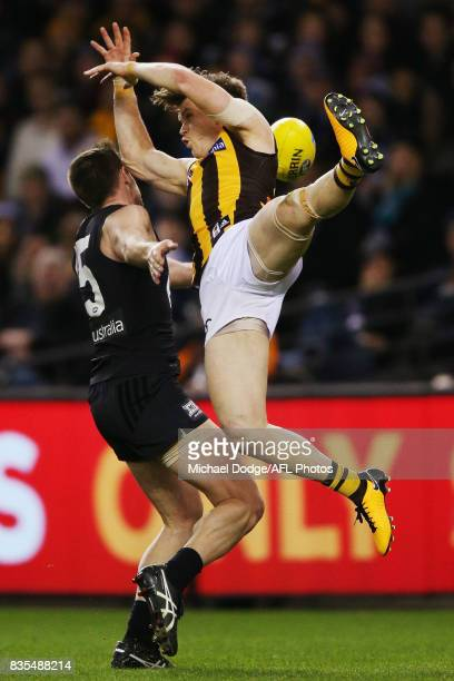 Sam Docherty of the Blues and Taylor Duryea of the Hawks compete for the ball during the round 22 AFL match between the Carlton Blues and the...