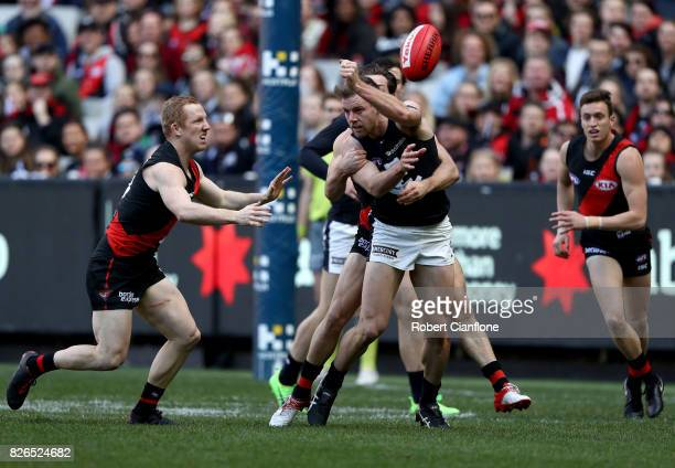 Sam Docherty of the Blues handballs during the round 20 AFL match between the Essendon Bombers and the Carlton Blues at Melbourne Cricket Ground on...