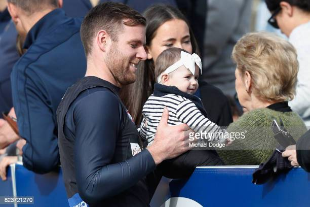 Sam Docherty of the Blues holds a baby during a Carlton Blues AFL training session at Visy Park on July 28 2017 in Melbourne Australia