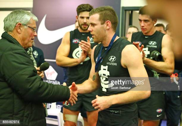 Sam Docherty of the Blues is presented with the David Parkin medal during the round 22 AFL match between the Carlton Blues and the Hawthorn Hawks at...