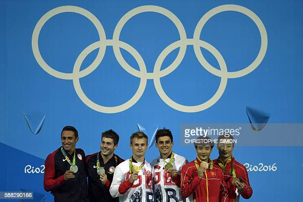 US Sam Dorman and Mike Hixon Great Britain's Jack Laugher and Chris Mears and China's Cao Yuan and Qin Kai pose during the podium ceremony for the...