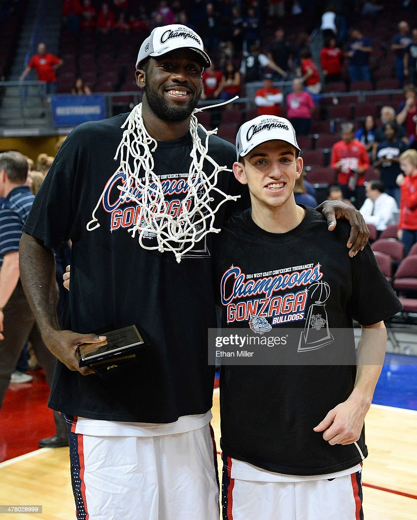 Sam Dower #35 (L) and David Stockton #11 of the Gonzaga Bulldogs pose on the court after cutting down a net after winning the championship game of the West Coast Conference Basketball tournament 75-64 over the Brigham Young Cougars at the Orleans Arena on March 11, 2014 in Las Vegas, Nevada.