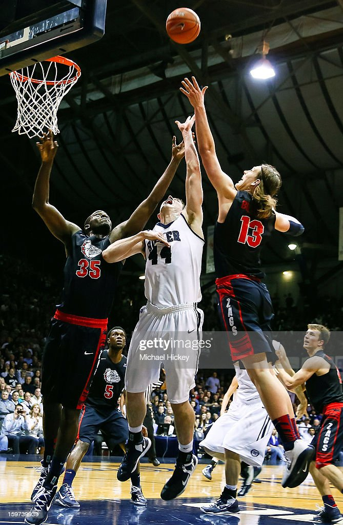 Sam Dower #35 of the Gonzaga Bulldogs Andrew Smith #44 of the Butler Bulldogs and Kelly Olynyk #13 of the Gonzaga Bulldogs battle for a rebound at Hinkle Fieldhouse on January 19, 2013 in Indianapolis, Indiana.