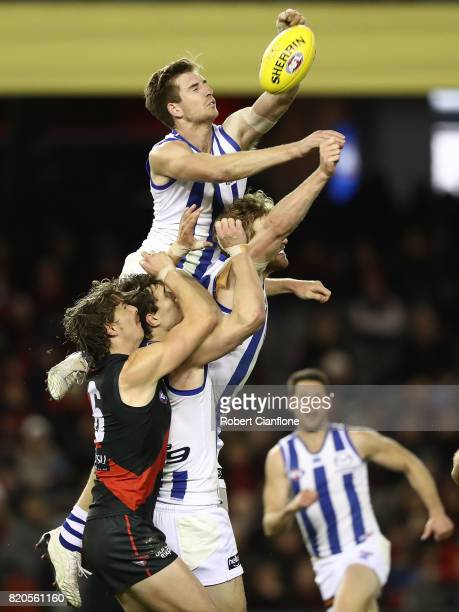 Sam Durdin of the Kangaroos punches the ball during the round 18 AFL match between the Essendon Bombers and the North Melbourne Kangaroos at Etihad...