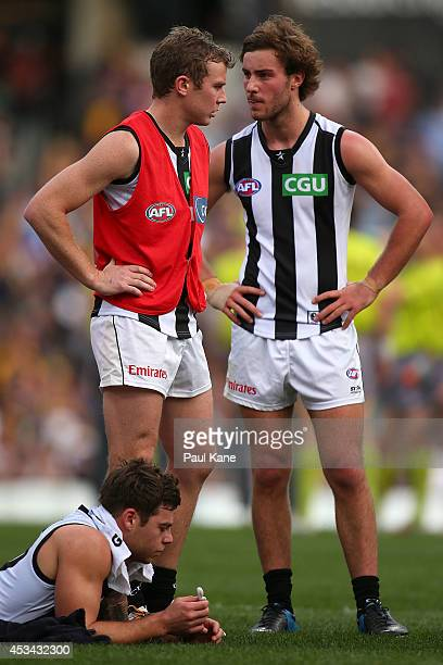 Sam Dwyer of the Magpies talks with Tim Broomhead at the three quarter time break during the round 20 AFL match between the West Coast Eagles and the...