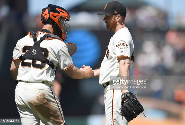 Sam Dyson and Buster Posey of the San Francisco Giants celebrates defeating the Pittsburgh Pirates 21 at ATT Park on July 26 2017 in San Francisco...