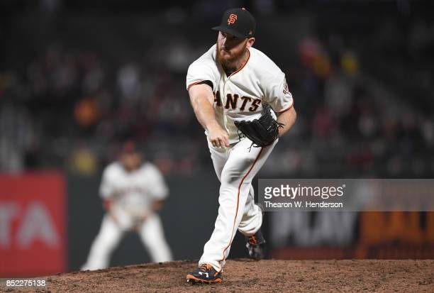 Sam Dyson of the San Francisco Giants pitches against the Colorado Rockies in the top of the ninth inning at ATT Park on September 19 2017 in San...