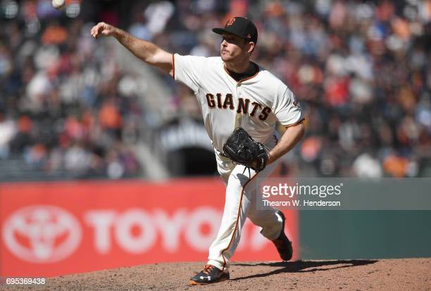 Sam Dyson of the San Francisco Giants pitches against the Minnesota Twins in the top of the ninth inning at ATT Park on June 11 2017 in San Francisco...