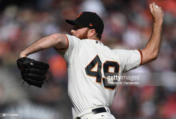 Sam Dyson of the San Francisco Giants pitches against the San Diego Padres in the top of the ninth inning at ATT Park on September 30 2017 in San...