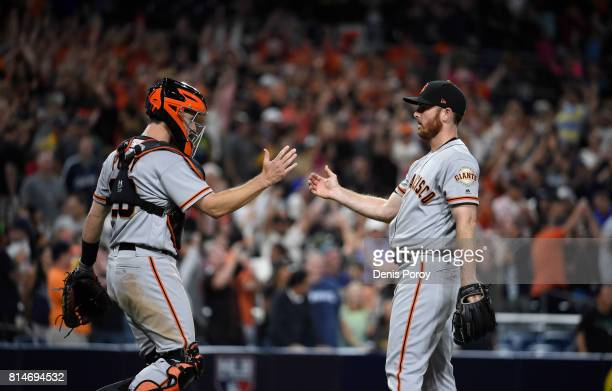 Sam Dyson of the San Francisco Giants right is congratulated by Buster Posey after beating the San Diego Padres 54 in a baseball game at PETCO Park...