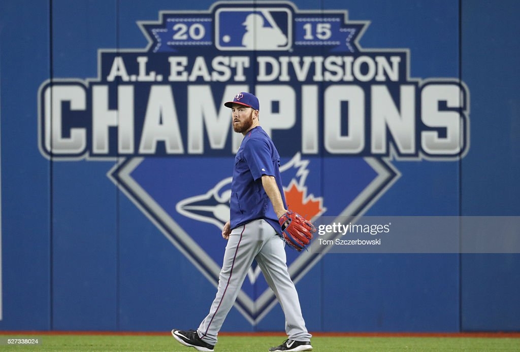 Sam Dyson #47 of the Texas Rangers walks in the outfield before the start of MLB game action against the Toronto Blue Jays on May 2, 2016 at Rogers Centre in Toronto, Ontario, Canada.