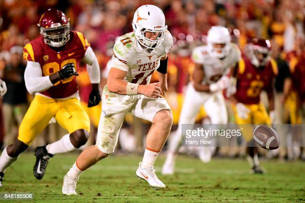Sam Ehlinger of the Texas Longhorns chases the ball after a bad snap during the fourth quarter against the USC Trojans at Los Angeles Memorial...