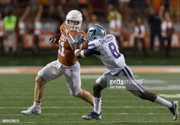 Sam Ehlinger of the Texas Longhorns looks to avoid a tackle by Duke Shelley of the Kansas State Wildcats in the fourth quarter at Darrell K...