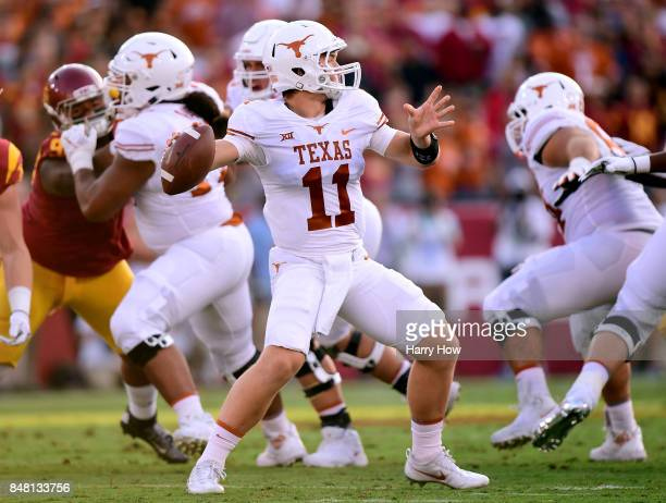 Sam Ehlinger of the Texas Longhorns passes during the first quarter against the USC Trojans at Los Angeles Memorial Coliseum on September 16 2017 in...