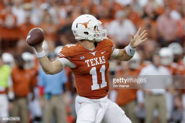 Sam Ehlinger of the Texas Longhorns throws a pass in the first quarter against the Kansas State Wildcats at Darrell K RoyalTexas Memorial Stadium on...