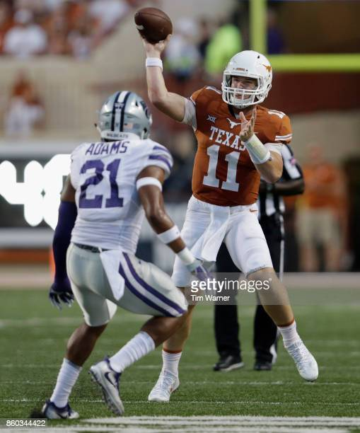 Sam Ehlinger of the Texas Longhorns throws a pass under pressure by Kendall Adams of the Kansas State Wildcats in the first half at Darrell K...