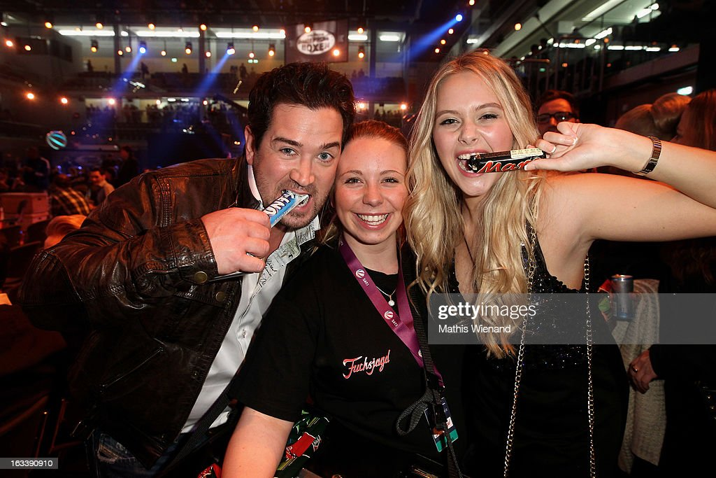Sam Eisenstein with Fabienne Rothe and a Fan attend the 'Das Grosse Sat.1 Promiboxen' at Castello on March 8, 2013 in Dusseldorf, Germany.