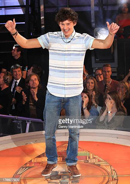 Sam Evans gestures as he greets fans after winning Big Brother during the final at Elstree Studios on August 19 2013 in Borehamwood England