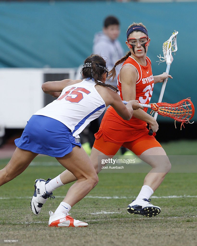 Sam Farrell #15 of the Florida Gators defends against Michelle Tumolo #35 of the Syracuse Orange during the 2013 Orange Bowl Lacrosse Classic on March 2, 2013 at SunLife Stadium in Miami Gardens, Florida.