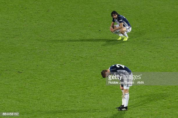 Sam Field of West Bromwich Albion and Ahmed Hegazy of West Bromwich Albion dejected at full time during the Premier League match between West...