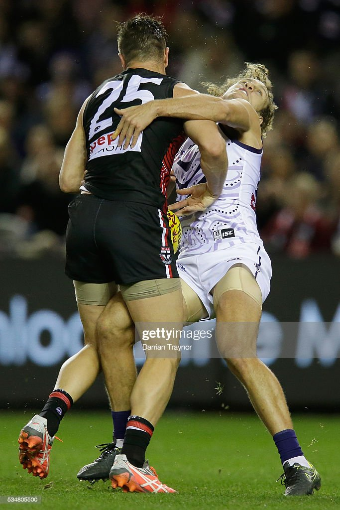 Sam Fisher of the Saints and Chris Mayne of the Dockers collide during the round 10 AFL match between the St Kilda Saints and the Fremantle Dockers at Etihad Stadium on May 28, 2016 in Melbourne, Australia.