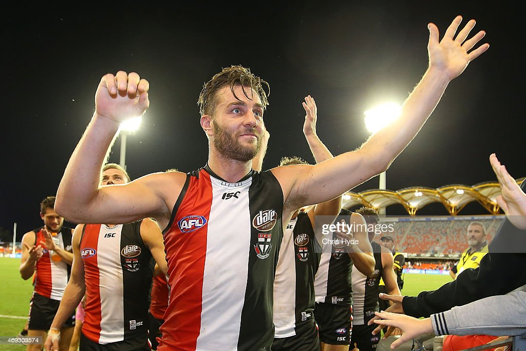 Sam Fisher of the Saints celebrates after playing his 200th game during the round two AFL match between the Gold Coast Suns and the St Kilda Saints at Metricon Stadium on April 11, 2015 in Gold Coast, Australia.