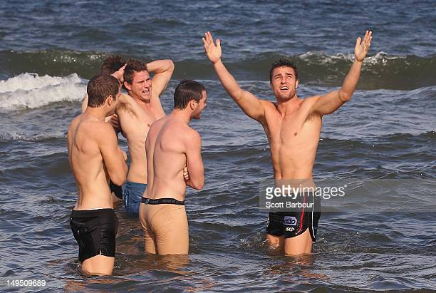 Sam Fisher of the Saints gestures as the sun comes out during a St Kilda Saints AFL recovery session at St Kilda Sea Baths on July 30 2012 in...