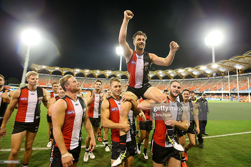 Sam Fisher of the Saints is chair from the field after playing his 200th game during the round two AFL match between the Gold Coast Suns and the St Kilda Saints at Metricon Stadium on April 11, 2015 in Gold Coast, Australia.