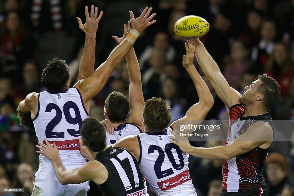 Sam Fisher of the Saints spolis the ball during the round 10 AFL match between the St Kilda Saints and the Fremantle Dockers at Etihad Stadium on May 28, 2016 in Melbourne, Australia.
