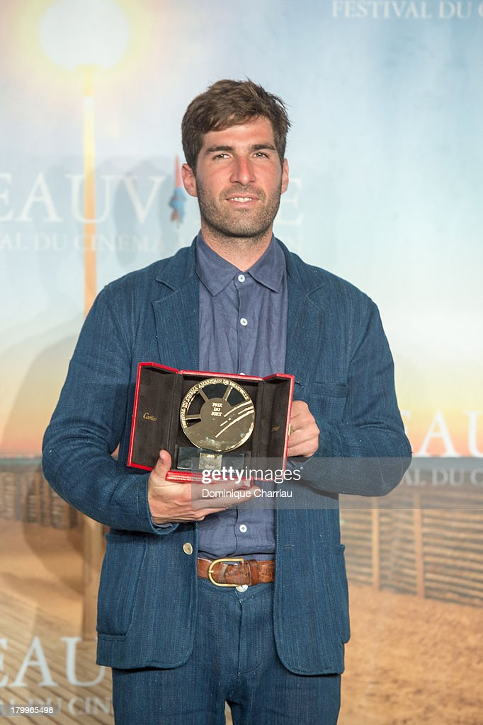 Sam Fleischner poses with the 'Jury prize' he won ex-aequo with his film 'Stand clear of the closing doors' on September 7, 2013 in Deauville, France.
