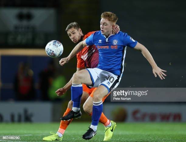 Sam Foley of Northampton Town contests the ball withCallum Camps of Rochdale during the Sky Bet League One match between Rochdale and Northampton...