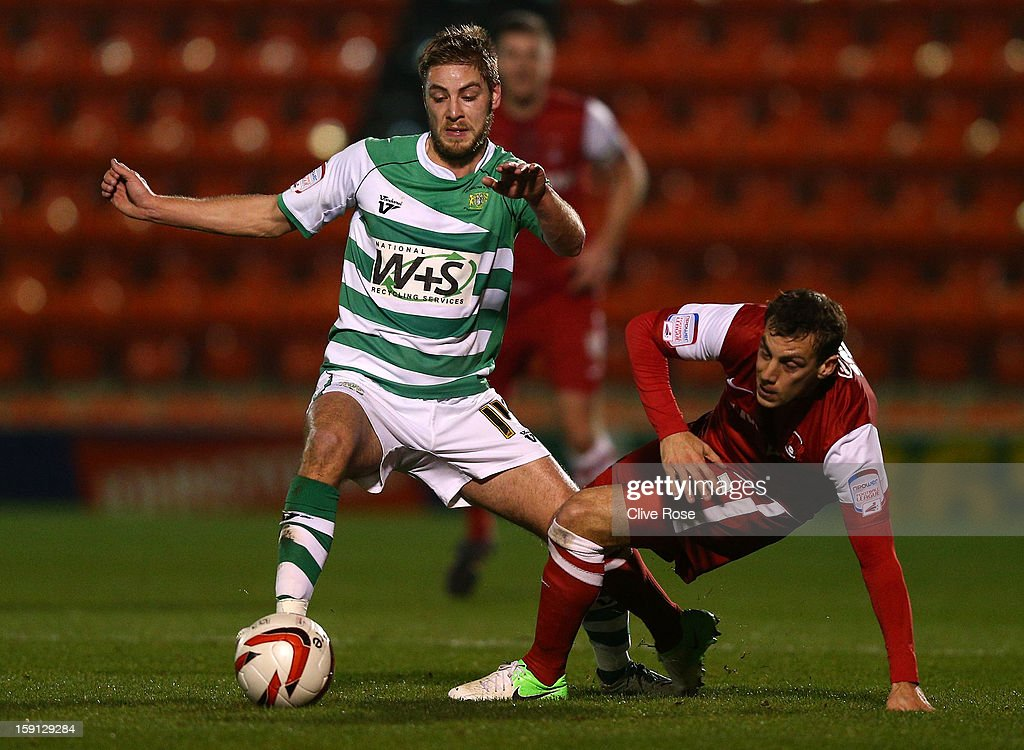 Sam Foley of Yeovil Town is challenged by Gary Sawyer of Leyton Orient during the Johnstone's Paint Trophy southern section semi final between Leyton Orient and Yeovil Town at the Matchroom Stadium on January 8, 2013 in London, England.