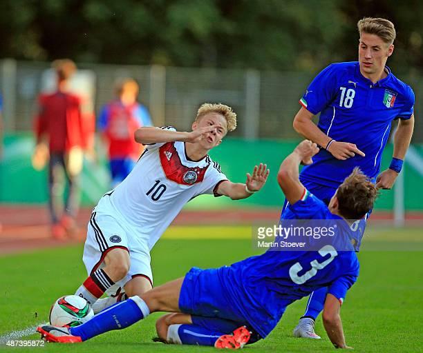 Sam Francis Schreck of U17 Germany challenges Luca Pellegrini of U17 Italy during the match between U17 Germany v U17 Italy at Weserstadion 'Platz...