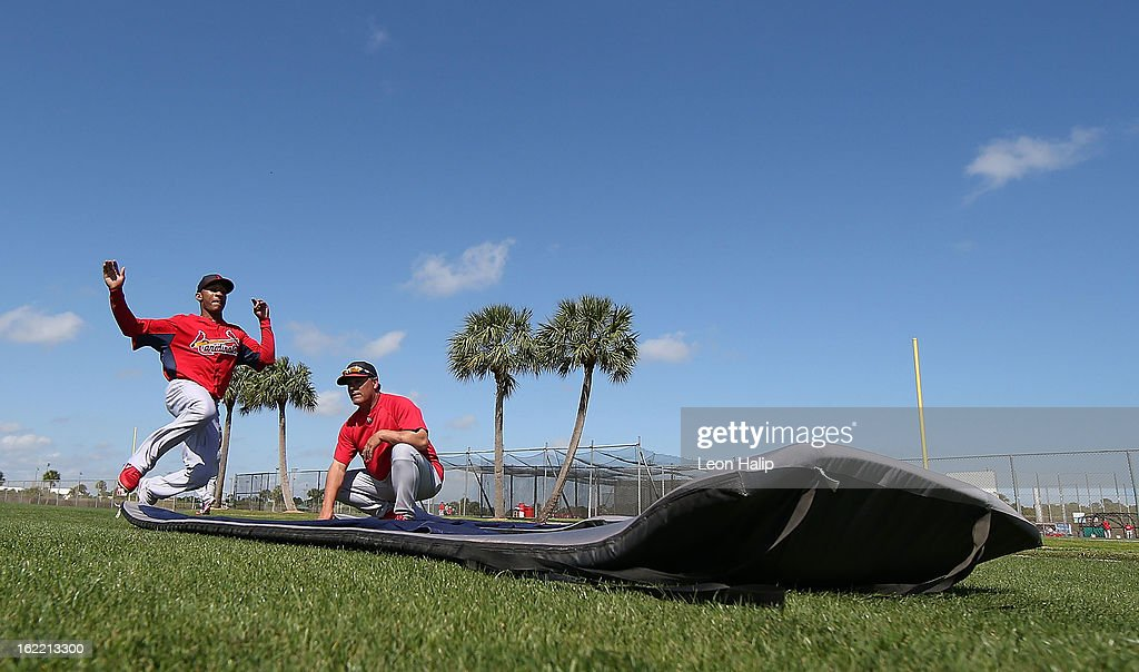 Sam Freeman #71 of the St. Louis Cardinals goes through the sliding drills during spring training on February 20, 2013 in Jupiter, Florida.