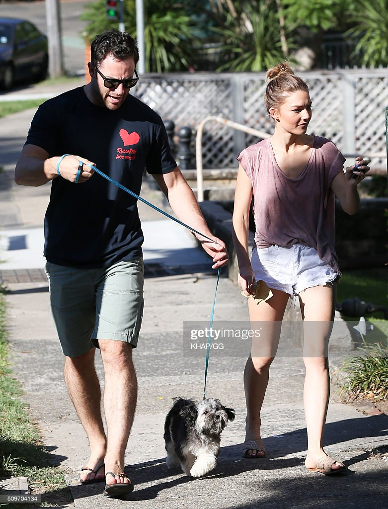 Sam Frost and boyfriend Sasha Mielczarek walk the dog on February 12, 2016 in Sydney, Australia.