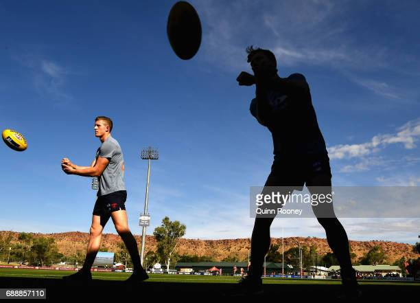 Sam Frost and Jake Melksham of the Demons warm up during the round ten AFL match between the Melbourne Demons and the Gold Coast Suns at Traeger Park...