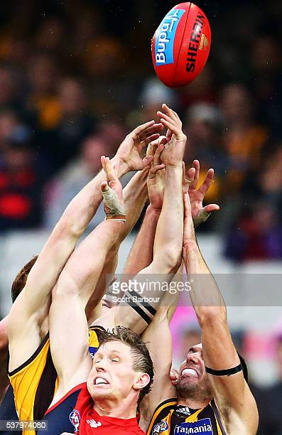 Sam Frost of the Demons and Jonathon Ceglar of the Hawks compete for the ball during the round 11 AFL match between the Hawthorn Hawks and Melbourne...