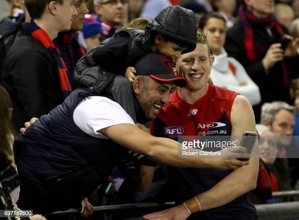 Sam Frost of the Demons celebrates after the Demons defeated the Bulldogs during the round 13 AFL match between the Western Bulldogs and the...