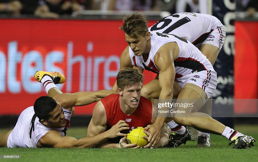 <a gi-track='captionPersonalityLinkClicked' href=/galleries/search?phrase=Sam+Frost+-+Aussie+Rules+Football+Player&family=editorial&specificpeople=15103438 ng-click='$event.stopPropagation()'>Sam Frost</a> of the Demons is challenged by his opponents during the round six AFL match between the Melbourne Demons and the St Kilda Saints at Etihad Stadium on April 30, 2016 in Melbourne, Australia.