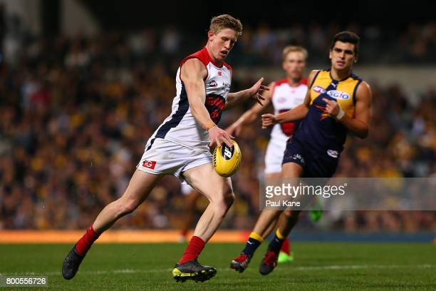 Sam Frost of the Demons passes the ball during the round 14 AFL match between the West Coast Eagles and the Melbourne Demons at Domain Stadium on...