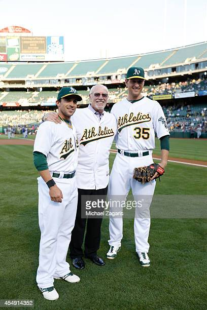Sam Fuld and Nate Freiman of the Oakland Athletics stand with former Athletics first baseman Mike Epstein on Jewish Heritage Night prior to the game...